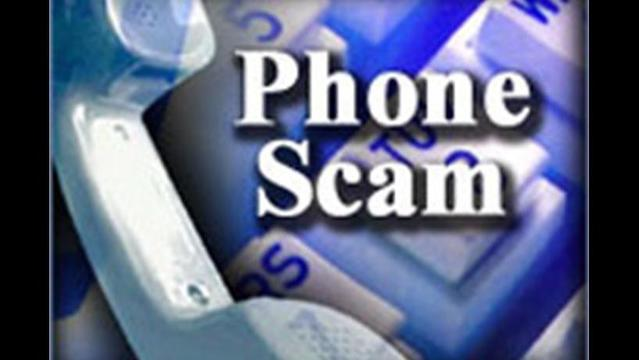 Scammers Pose AS IRS Agents